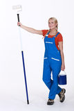 Woman stood with paint roller Royalty Free Stock Photos