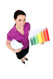 Woman stood with rating board. Woman stood with energy rating board stock image