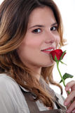 Woman stood with rose Royalty Free Stock Images