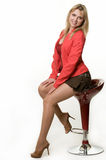 Woman on stool Royalty Free Stock Images