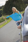 Woman stopping car. Young woman stopping car in countryside Stock Photos