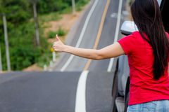 Woman stopping car Stock Photography
