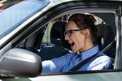 Woman stopping the car and screaming Stock Images