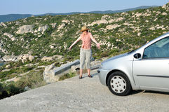 Woman stopping the car and showing to the end of the road Royalty Free Stock Photo