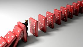 Domino Chain Reaction. Woman stopping a chain reaction of red dominoes Royalty Free Stock Photo