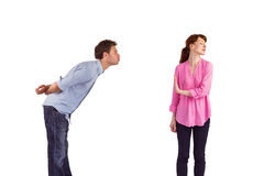 Woman stopping man from kissing Royalty Free Stock Photo