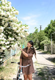 Woman stopping to admire a tree in blossom Stock Images