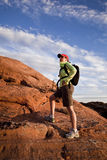 Woman stops while hiking Stock Images