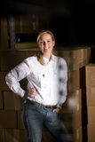 Woman in storage room Royalty Free Stock Image