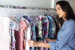 Woman in a store buying clothes stock photo