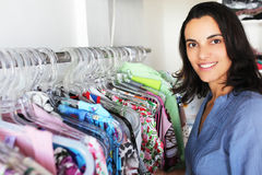 Woman in a store buying clothes Stock Image