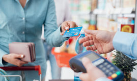 Woman at the store checkout stock images
