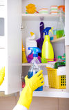 Woman storing cleaning tools in pantry Stock Images