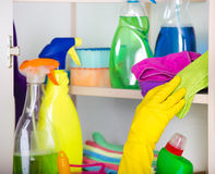 Woman storing cleaning tools in pantry Stock Photos