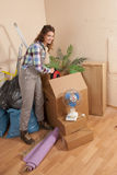 Woman storing something in a big moving box Royalty Free Stock Images