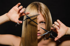 Woman with straight hair and scissors royalty free stock photography