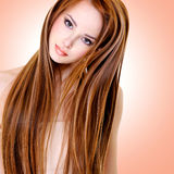 Woman with straight hairs. Portrait of the beautiful young woman with long straight hairs royalty free stock images