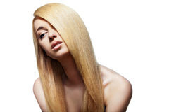 Woman with straight long blond hair isolated. Well-being & spa. Sensual woman model with shiny straight long blond hair. Health, beauty, wellness, haircare Stock Image