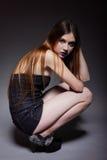 Woman straight long hair make-up posing. In studio dark background Stock Image