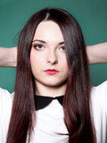 Woman straight long hair make-up posing Royalty Free Stock Photo
