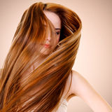 Woman with straight long hairs. Portrait of woman with straight long hairs posing at studio royalty free stock image