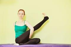 Woman straighting leg Stock Photo