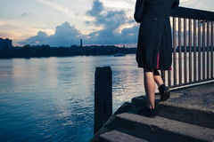 Woman stranding on stairs by river Royalty Free Stock Photos