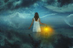 Woman in strange and surreal waters. Weird and fantasy royalty free stock photos