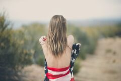 Woman Strapping Her Body of American Flag Stock Image