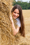 Woman and straw Stock Image