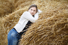 Woman on a straw background Stock Photos