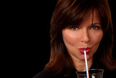 Woman With Straw on Black Royalty Free Stock Image