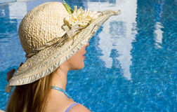Woman in straw hat. At pool stock images
