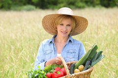 Woman in straw hat with basket Stock Photography