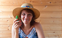 Woman in straw hat with cucumber Stock Photo