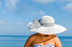 Woman with straw hat enjoying summer holidays Royalty Free Stock Photo