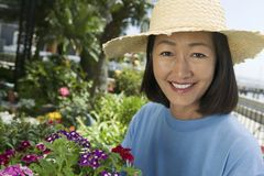 Woman in straw hat gardening Royalty Free Stock Images