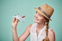 Woman in straw hat holding airplane model in hand Royalty Free Stock Image