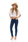 Woman In Straw Hat, Jeans And High Heels Stock Photo