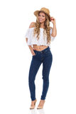 Woman In Straw Hat, Jeans And High Heels Isolated Stock Photo