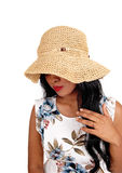Woman with straw hat looking down. Royalty Free Stock Photography