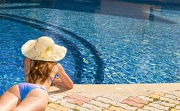 Woman in straw hat near the pool Stock Photography