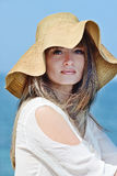 Woman in straw hat. Over the sea background Royalty Free Stock Image