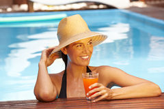 Woman with straw hat in pool Stock Photos