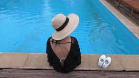 Woman in straw hat at the pool stock video footage