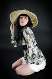 Woman in straw hat posing on black background Royalty Free Stock Images