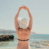 Woman with straw hat protects from sun Stock Photography