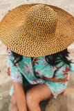 Woman in straw hat at sandy beach on a sunny day Stock Photography