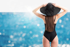 Woman with straw hat at sea Royalty Free Stock Image
