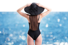 Woman with straw hat at sea Royalty Free Stock Images
